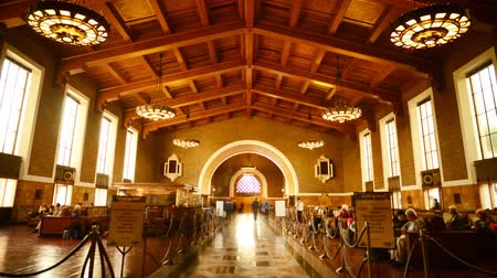 train workers : Time Lapse footage of commuters in the historic hallway at Union Station in Los Angeles, California USA Stock Footage