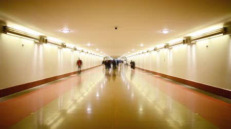 crowded : Time Lapse footage with tilt up motion of commuters in the hallway at Union Station in Los Angeles, California USA