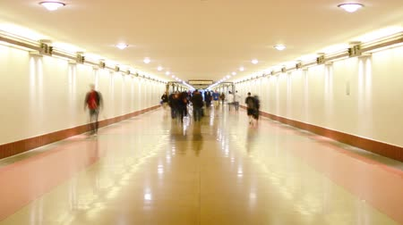 train workers : Time Lapse footage with zoom in motion of commuters in the hallway at Union Station in Los Angeles, California USA