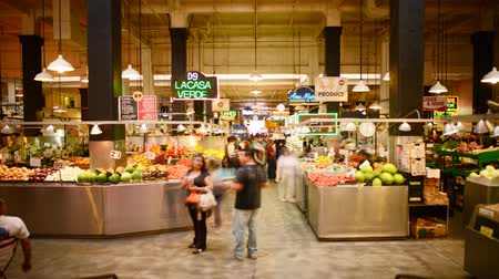 local population : Time lapse footage with tilt down motion of shoppers at historic Grand Central Market in downtown Los Angeles, California