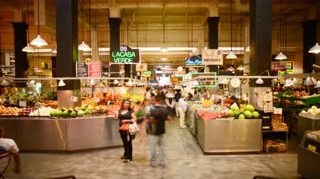 local population : 4K time lapse footage with tilt down motion of shoppers at historic Grand Central Market in downtown Los Angeles, California