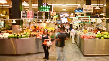bakkaliye : 4K time lapse footage with pan right motion of shoppers at historic Grand Central Market in downtown Los Angeles, California