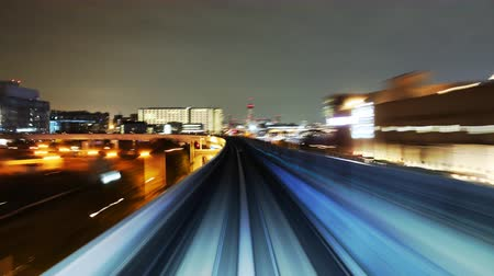 japonya : poin of view time lapse footage of Yurikamome, automated guideway transit train system in Tokyo, Japan at night