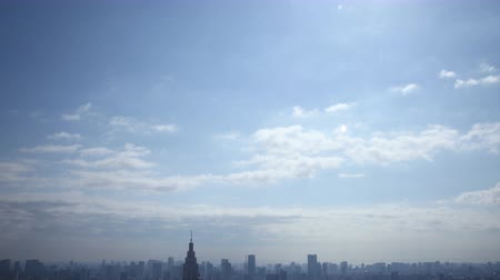 crowded : Time lapse footage with zoom out motion of daytime cloudscape over metropolitan cityscape shot atop Tochou Capitol Government Building in Shinjuku, Tokyo, Japan
