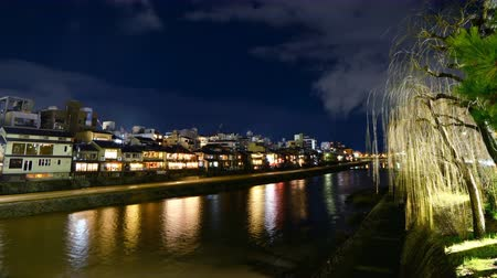 kyoto : Time lapse footage with zoom out motion of traditional restaurant buildings along Kamogawa river in Kyoto, Japan at night