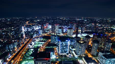 határkő : Time lapse footage with tilt down motion of metropolitan cityscape at night shot from Yokohama Landmark Tower in Japan Stock mozgókép