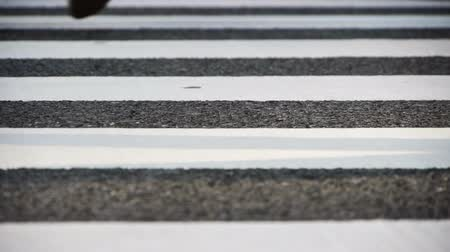 charakteristický : Footsteps of commuters in famous Shibuya crosswalk at rush hour in Tokyo, Japan