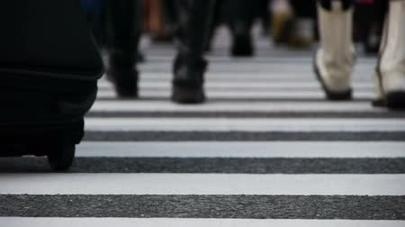 crosswalk : Footsteps of commuters in famous Shibuya crosswalk at rush hour in Tokyo, Japan