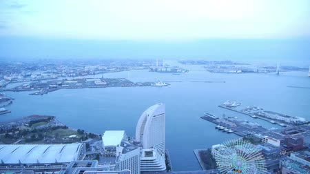 crowded : Time lapse footage of metropolitan cityscape from day to night shot from Yokohama Landmark Tower in Japan