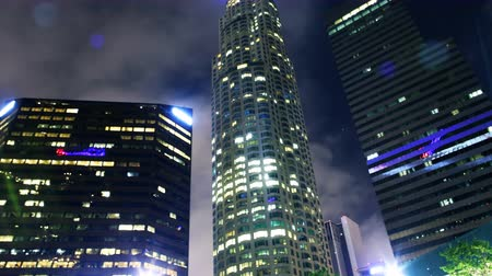 budynki : Time lapse footage with tilt up motion of low angle shot of skyscrapers with clouds at night in downtown Los Angeles, California Wideo