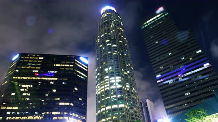 corporativa : Time lapse footage of low angle shot of skyscrapers with clouds at night in downtown Los Angeles, California