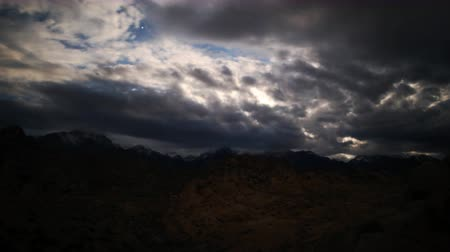 alpy : Astrophotography time lapse footage of overcast cloudscape giving way to starry sky over Sierra Nevada Mountains in California