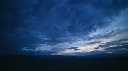 celestial : Time lapse footage of clouds over desert sand dunes at sunrise in Death Valley National Park, California