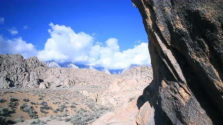 nevada : 3 axis motion controlled time lapse footage with dolly up, tilt up  pan right motion of rugged rock formation and cloudscape at Alabama Hills in Sierra Nevada Mountains in California Stock Footage