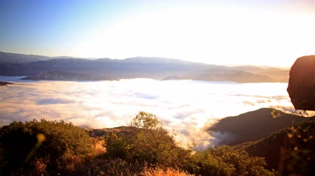 nedvesség : 3 axis motion controlled time lapse footage with dolly left, tilt down and pan right motion of sunrise over golden sea of clouds in Santa Barbara, Calfiornia