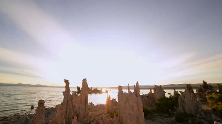 мистический : Footage with pan left motion of otherworldly formations of Tufas at sunrise at Mono Lake, California