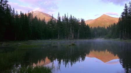 nevada : Footage with pan right motion of perfect reflective alpine lake at twilight in Yosemite National Park, California