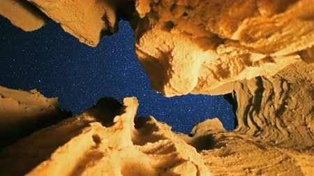 barlang : 3 axis motion controlled astrophotography time lapse footage with dolly right, tilt down  pan right motion of starry sky through eroded sandstone cave at Red Rock Canyon State Park in Mojave Desert, California
