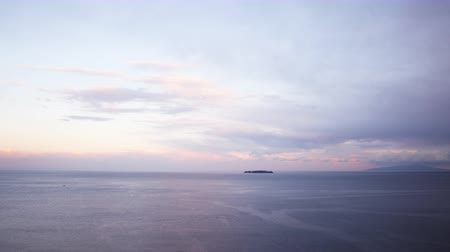 fırtına : Motion controlled pan left time lapse footage with zoom out motion of heavenly clouds moving over eternal seascape during sunset shot atop a cliff in Atami, Shizuoka, Japan