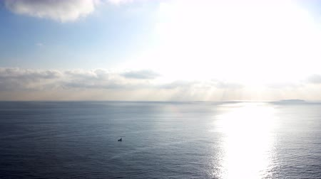 небесный : Time lapse footage with pan right motion of morning sun ray through heavenly cloudscape over sea horizon Стоковые видеозаписи