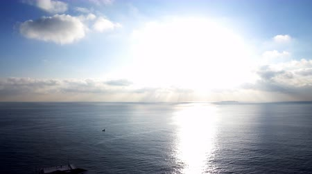 небесный : Time lapse footage with tilt down motion of morning sun ray through heavenly cloudscape over sea horizon Стоковые видеозаписи