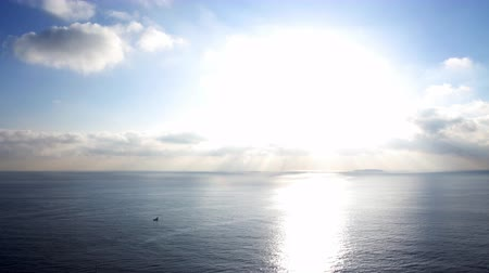 небесный : Time lapse footage with zoom in motion of morning sun ray through heavenly cloudscape over sea horizon Стоковые видеозаписи