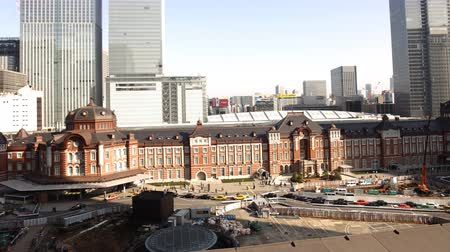 4K Motion controlled pan left time lapse footage of historic Tokyo Station during the daytime in Japan