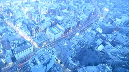 4K Time lapse footage with tilt up motion of twilight cityscape from day to night shot atop Sunshine 60 in Ikebukuro, Tokyo, Japan