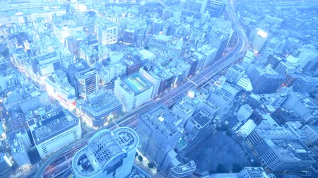 4K Time lapse footage of twilight cityscape from day to night shot atop Sunshine 60 in Ikebukuro, Tokyo, Japan