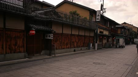 hanamikoji : 4K Motion controlled pan left tilt up time lapse footage with zoom out motion of historic Hanamikoji street in Gion district of Kyoto, Japan in the morning