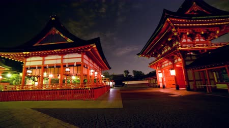 sagrado : 4K Motion controlled time lapse with pan left  tilt up motion of Fushimi Inari Shrine in Kyoto, Japan