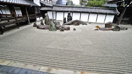 Traditional Japanese garden in Toufuku-ji in Kyoto, Japan -tracking tilt uppan right-