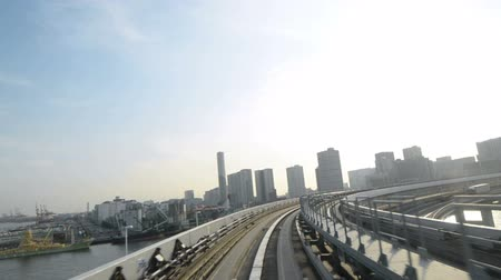 Poin of view time lapse footage of Yurikamome, automated guideway transit train system in Tokyo, Japan in the evening