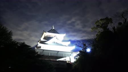 4K Astrophotography time lapse footage with pan left motion of historic Japanese Castle under the starry sky at night in Atami, Shizuoka, Japan Wideo