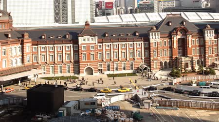 Motion controlled pan left time lapse footage with zoom in  out motion of historic Tokyo Station during the daytime in Japan