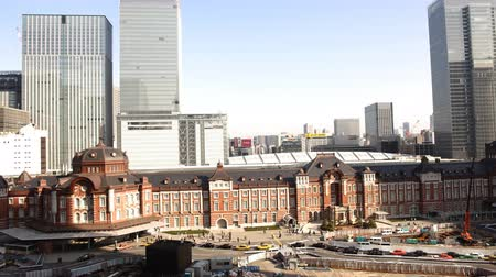4K Motion controlled pan left time lapse footage with tilt down motion of historic Tokyo Station during the daytime in Japan Wideo