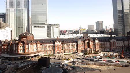 4K Motion controlled pan left time lapse footage with zoom out  in motion of historic Tokyo Station during the daytime in Japan