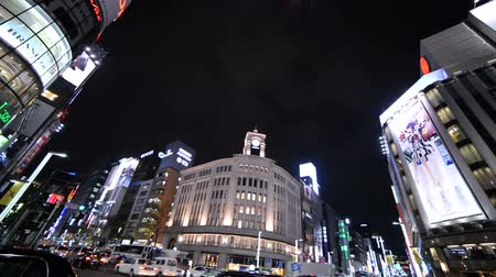 Footage of Ginza crosswalk in Tokyo Metropolitan district in Japan at night -tilt down-