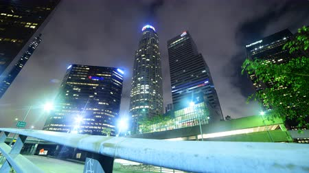 4K 3 axis motion controlled time lapse footage with dolly up, tilt up & pan left motion of skyscrapers at Bunker Hill Financial District in downtown Los Angeles, California Wideo