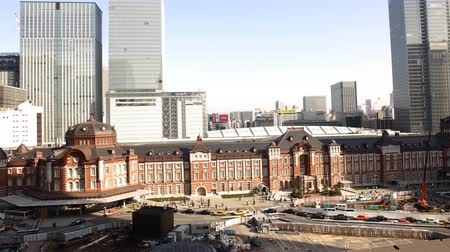 4K Motion controlled pan left time lapse footage with tilt up motion of historic Tokyo Station during the daytime in Japan