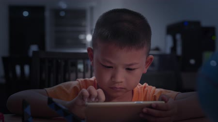 mais : Child is playing mobile phone Can it irritate the eyes.Kid stare at mobile. Stock Footage