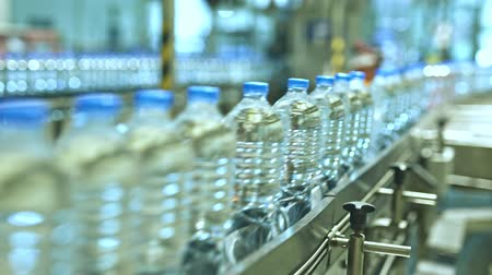 alkoholik : New water plastic Bottles on conveyor belt at factory.