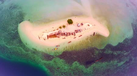 fishing village : Beautiful small island in the malaysia.  Top view of an island in the Malaysia.   Aerial view of the Island with a small fishermens.   Malaysia of life in island with a small fishing village.    Scenic aerial view of small fishing village in malaysia.  Sm