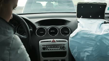 dismay : The girl in the car with blown airbags after accident