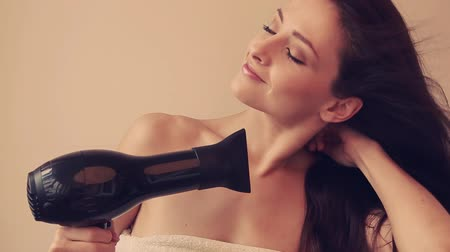 сухой : Happy young woman drying long hair