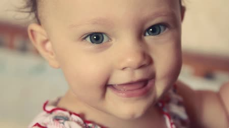 baby blue : Fun happy baby girl looking. Closeup vintage effect Stock Footage