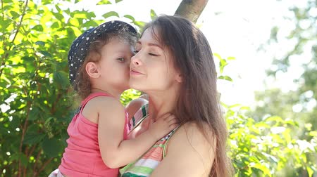 мама : Kid girl kissing joying happy mother outdoors summer background