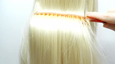 blond vlasy : brushing highlight blond hair texture background