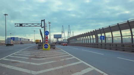 ограждение : two roads to different ways, two routes on highway saint peterburg, russia. vatnovy bridge on the background
