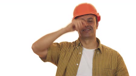 renovar : Handsome mature engineer wearing hardhat smiling confidently Stock Footage